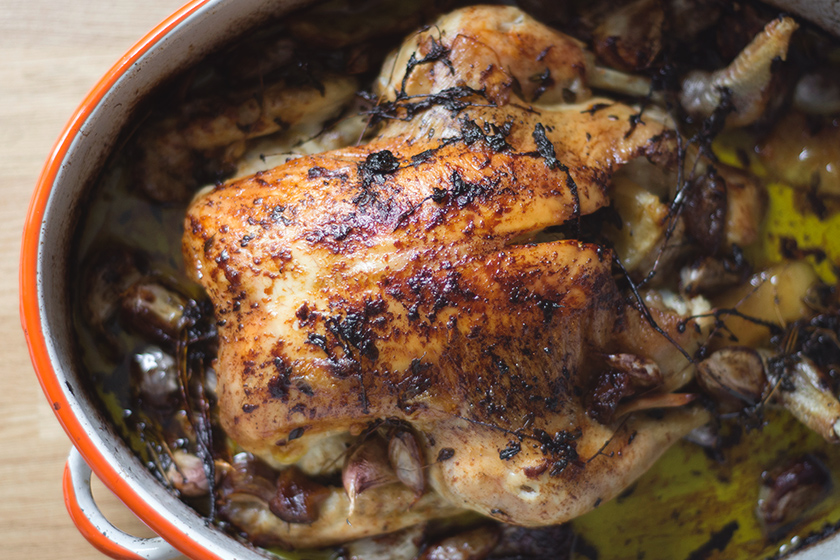 Roasted chicken in roasting pan