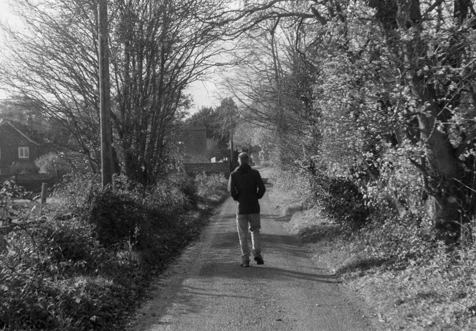 Man walking down lane