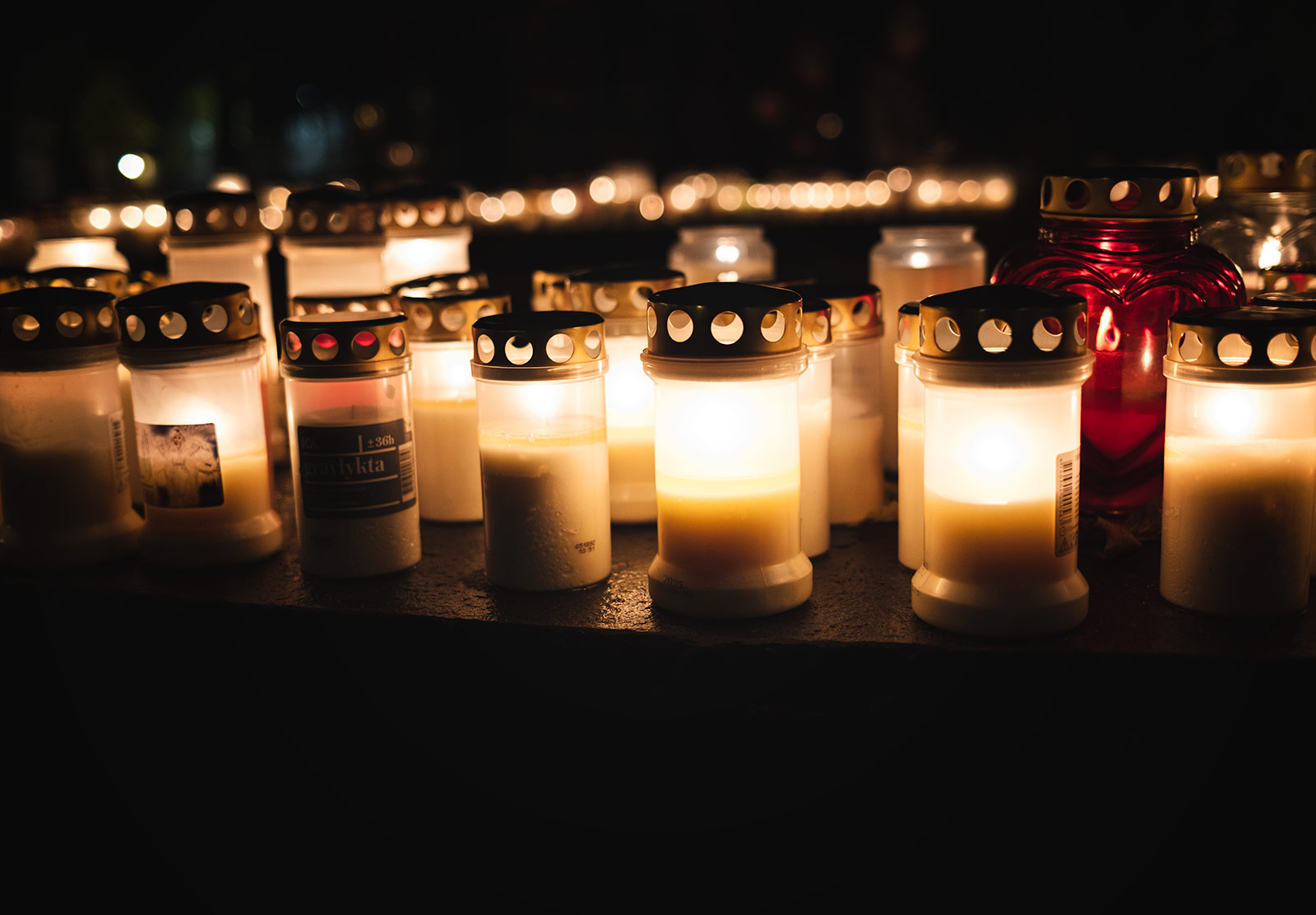 Row of candles in jars