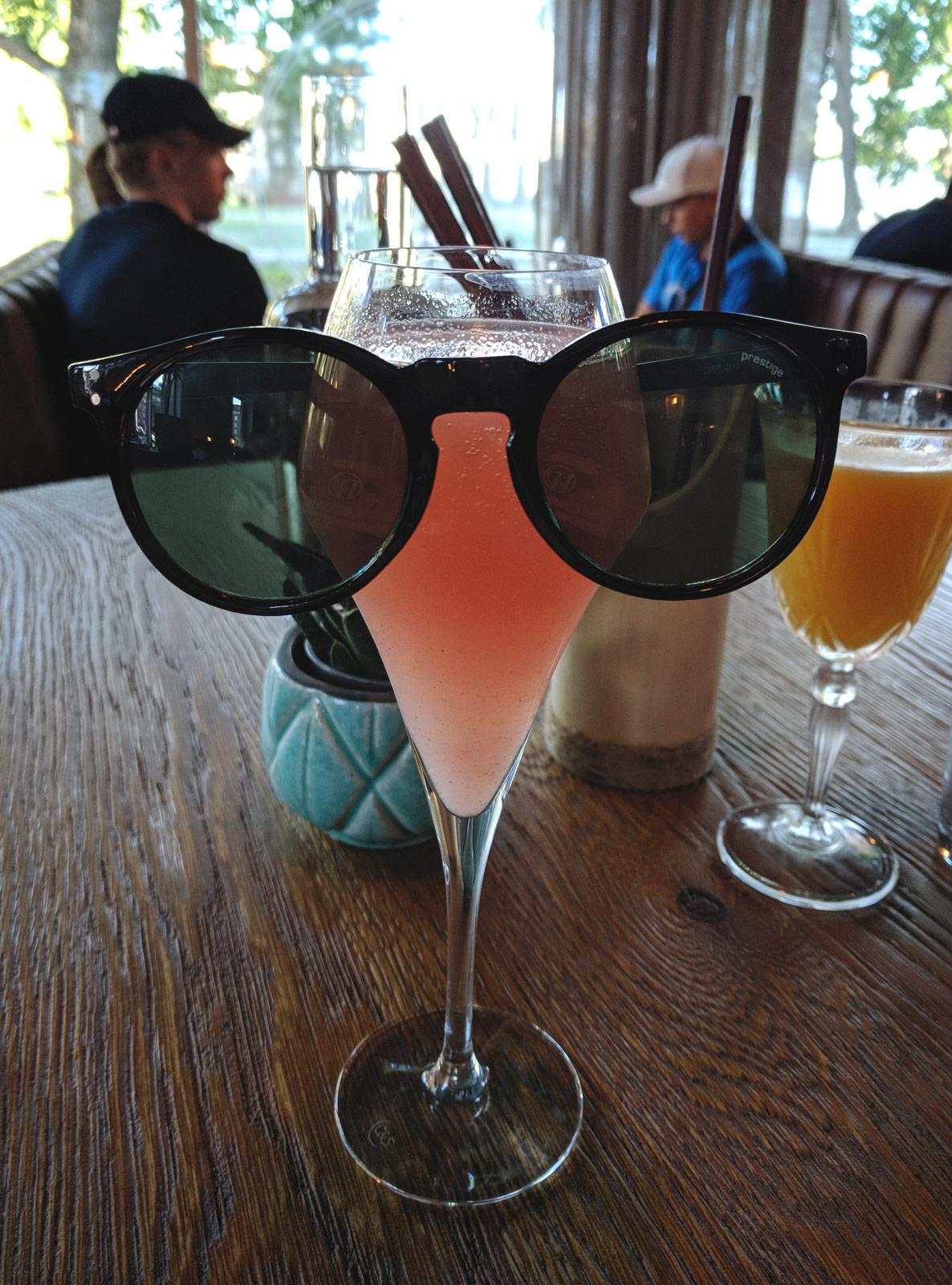 Sunglasses on peach bellini
