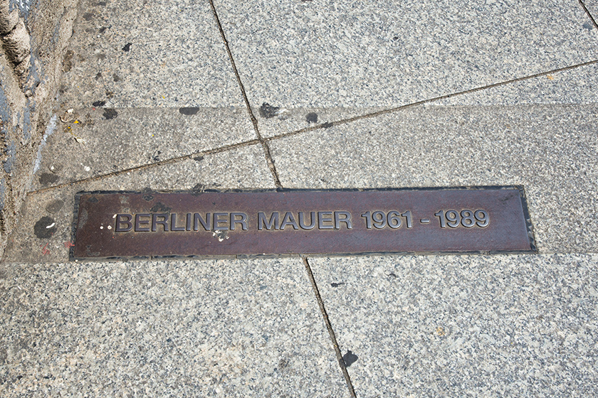 Metal plaque in paving