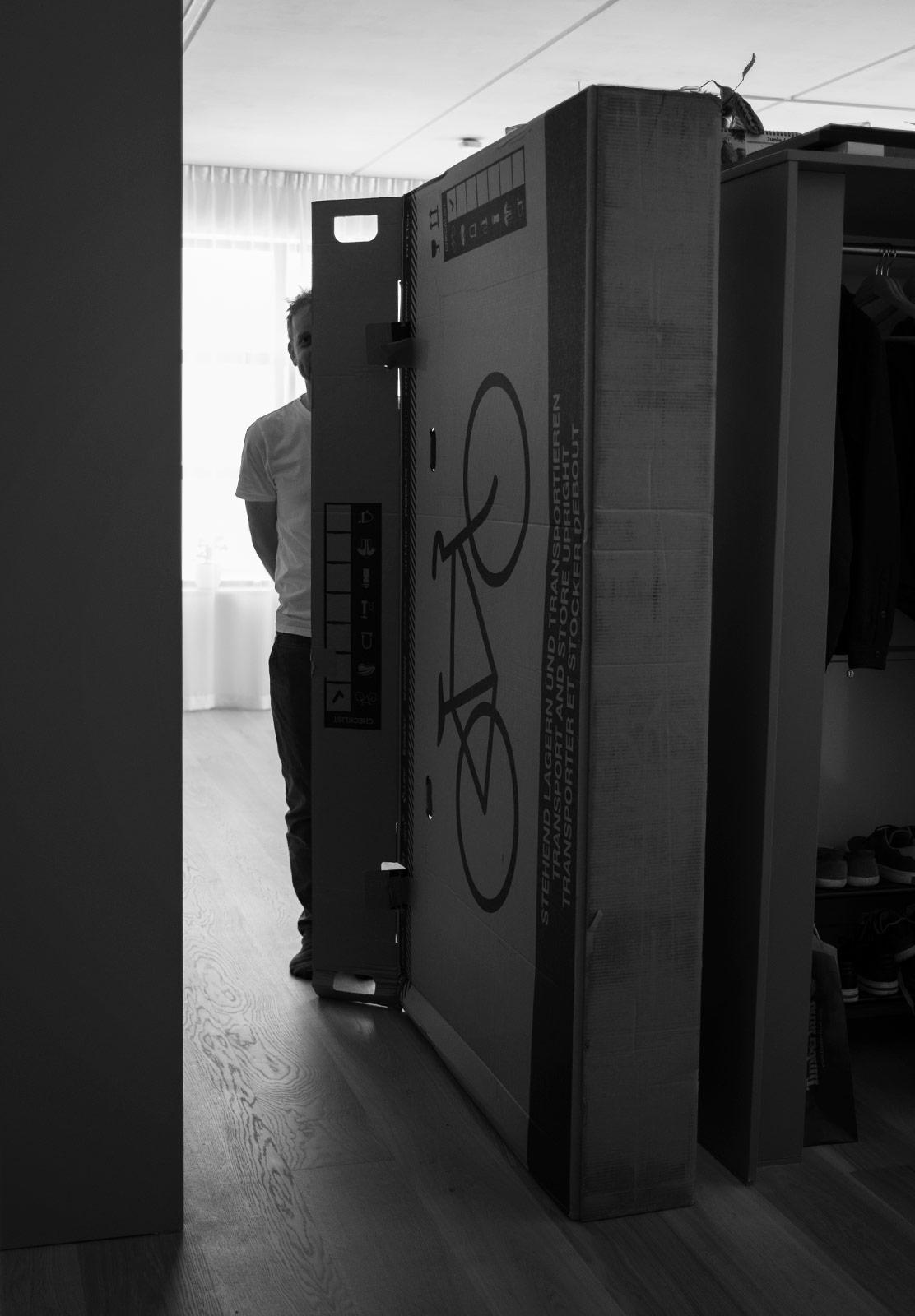 Man standing next to tall box
