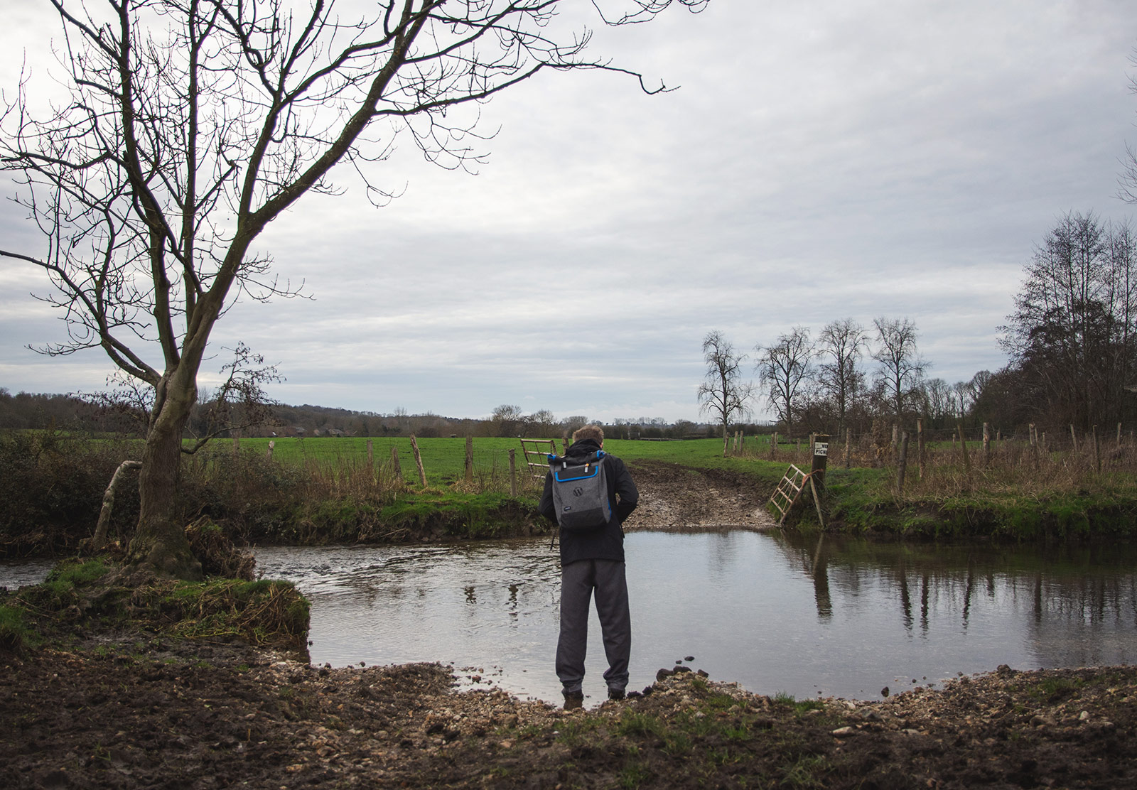 Man standing in stream