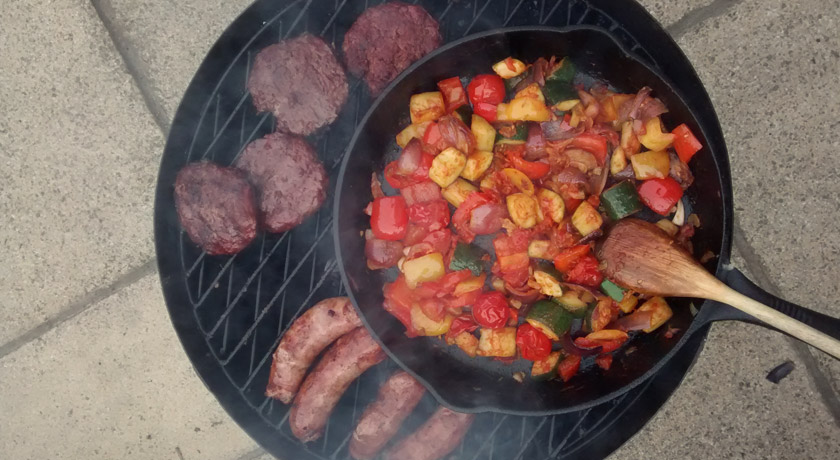 Skillet and meat on BBQ