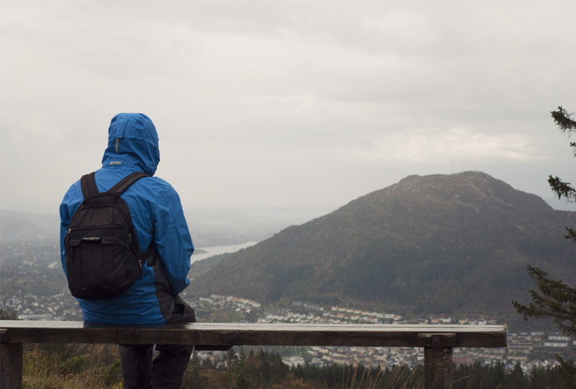 Man overlooking Bergen from mountaintop