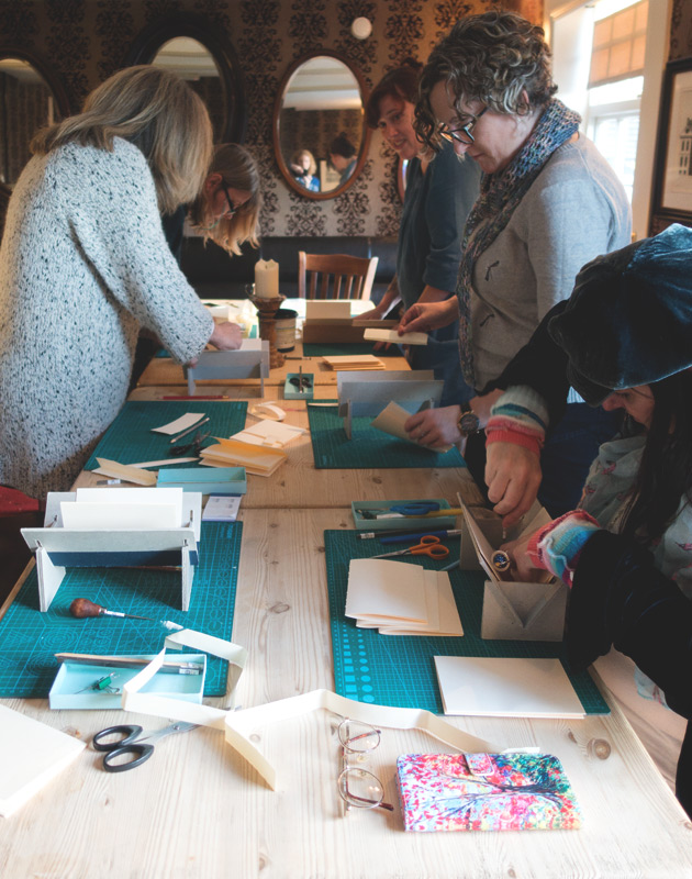 Bookbinding group at table