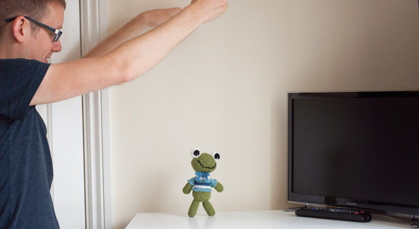 Felix the frog held up with string