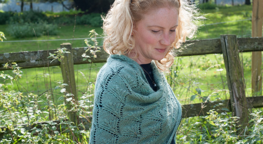 Wrapped in green wool shawl