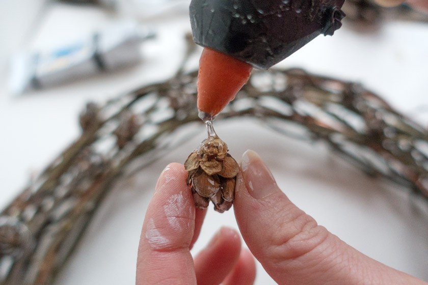 Glue gun and pinecones