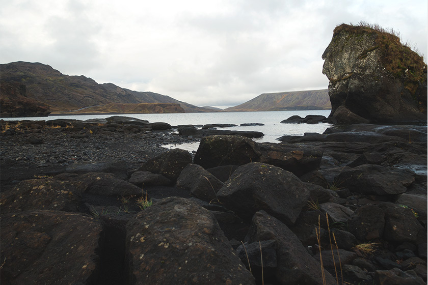 Black rocks at lake edge