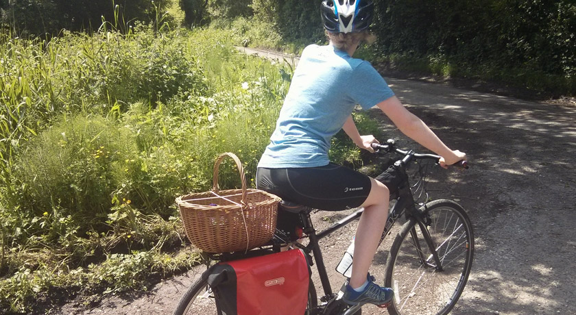 Wicker basket strapped to bike
