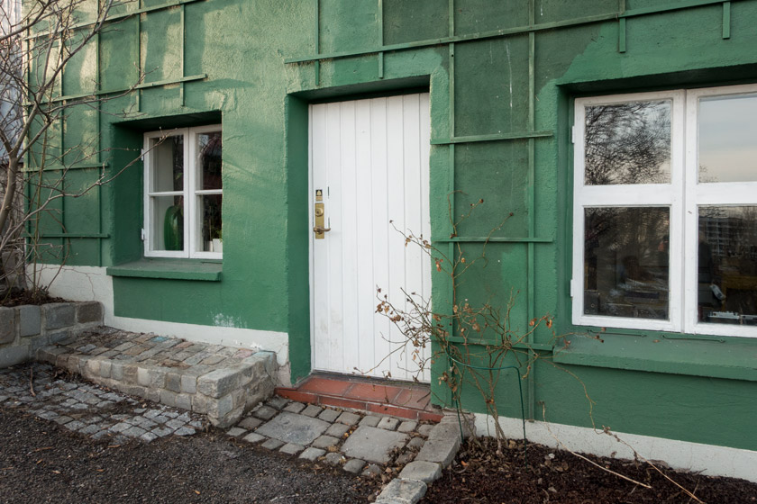 Green house with white windows