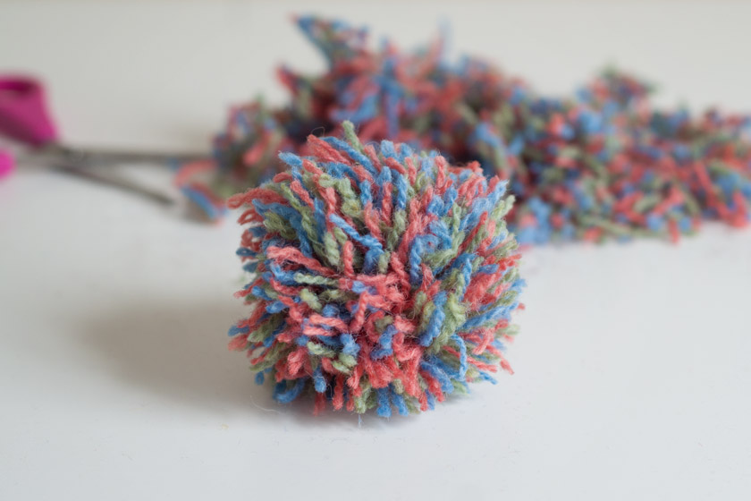 Pompom with wool in background