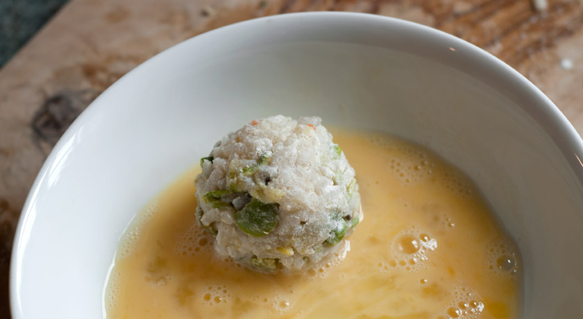 Rolling risotto ball in egg