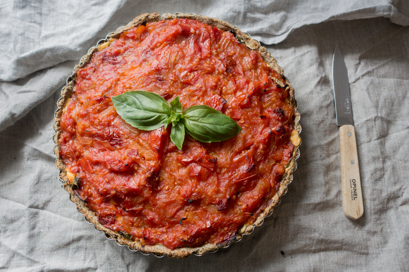 Tomato tart with basil garnish
