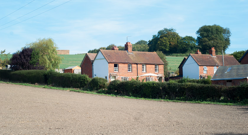 Cottages next to empty fields