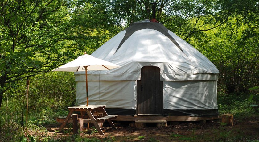 Yurt and wooden picnic table