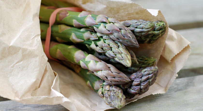 Fresh asparagus in a paper bag