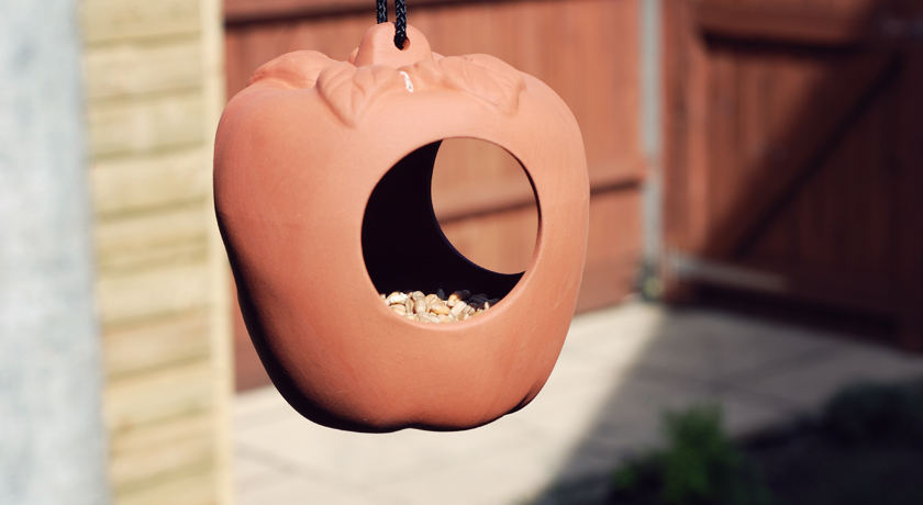 Terracotta bird feeder