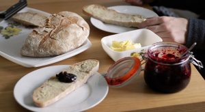 Bread, butter and jam on breakfast table