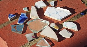 Pieces of broken ceramic pots and mirrors