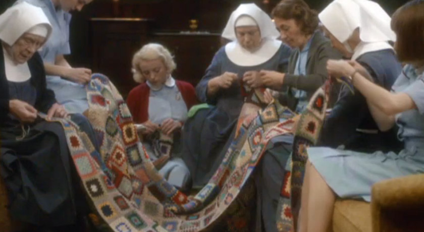 Nuns and midwives sewing a blanket