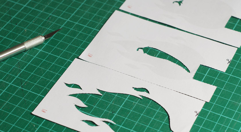 Cut out paper stencils in a row