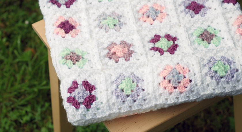 Pastel color crochet granny square blanket