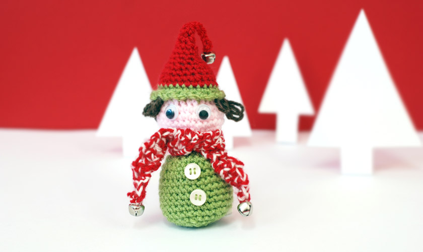 Crochet elf wearing a hat with bells on