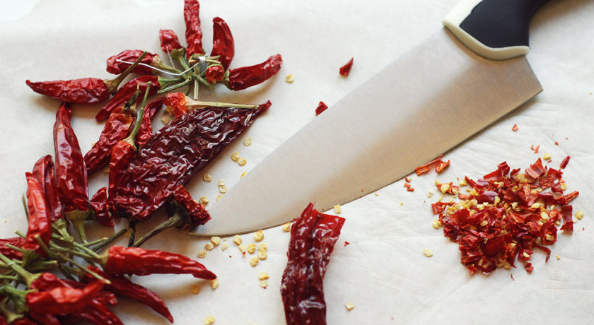 Dried chillies on chopping board