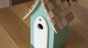 Mint green wooden bird house