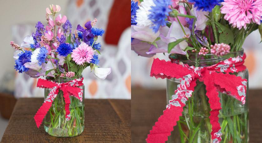 Jam jar posie of wild flowers