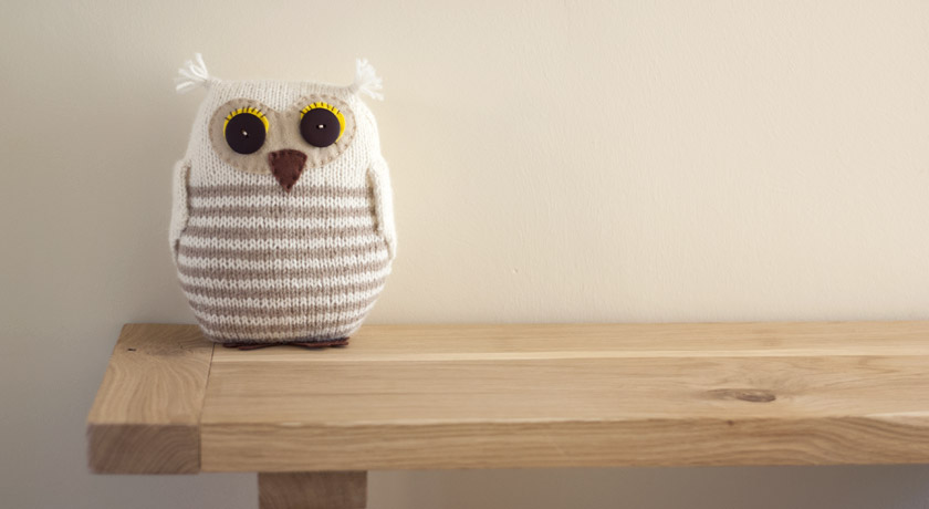 Knitted owl with stripes