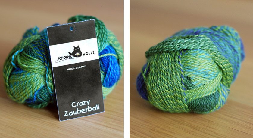 Green and blue yarn on table with tag
