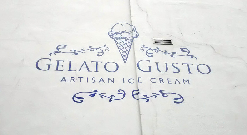 Gelato Gusto sign painted on wall