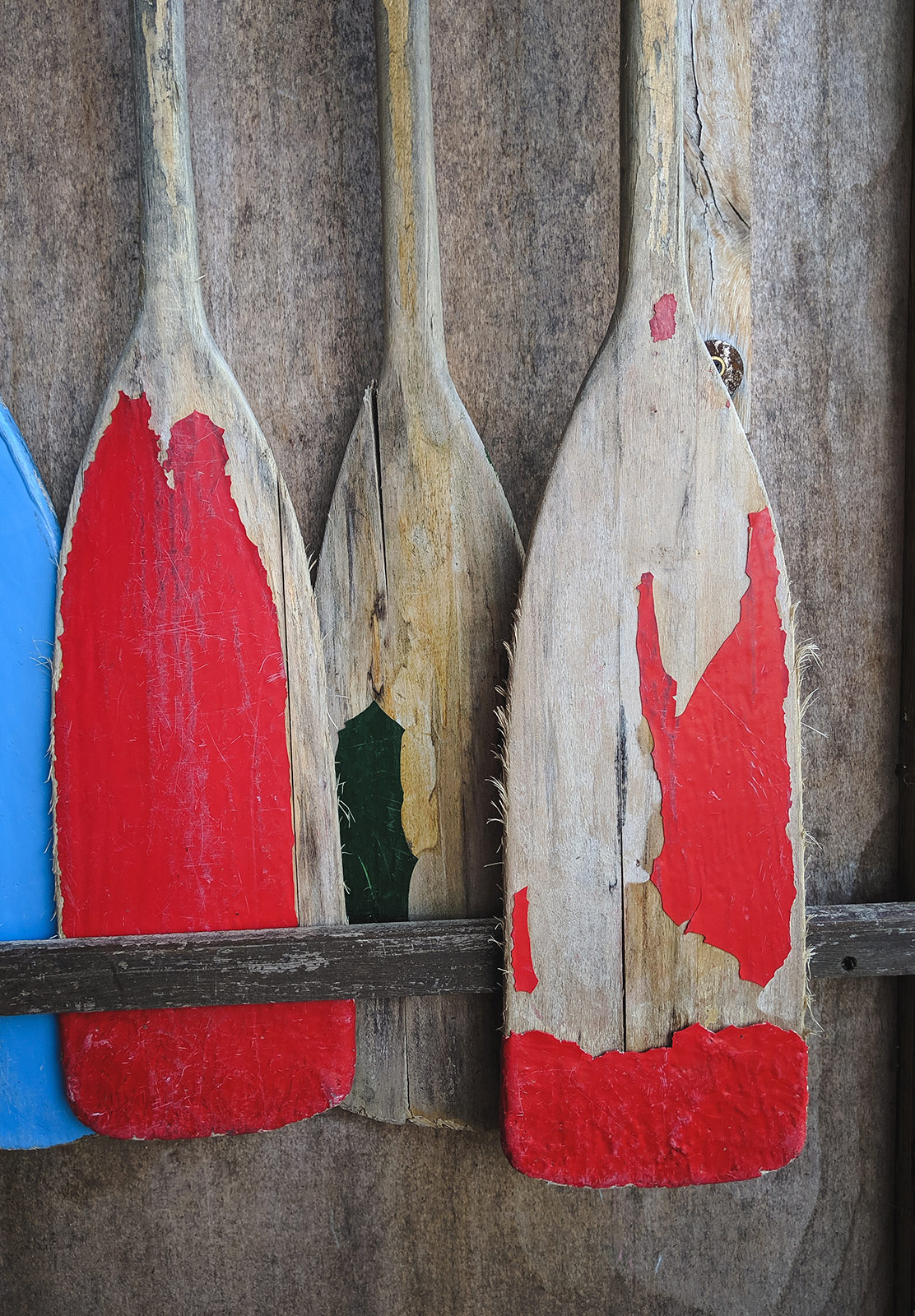 Old painted wooden paddles