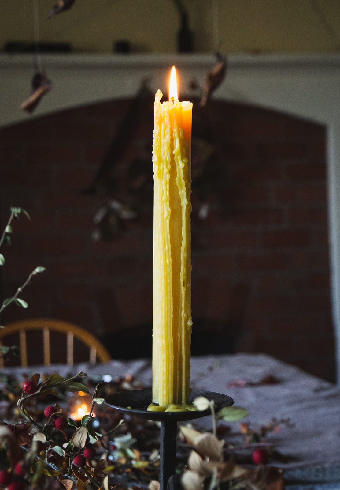 Dripping beeswax candle