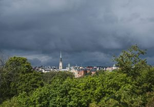 Dark clouds behind church
