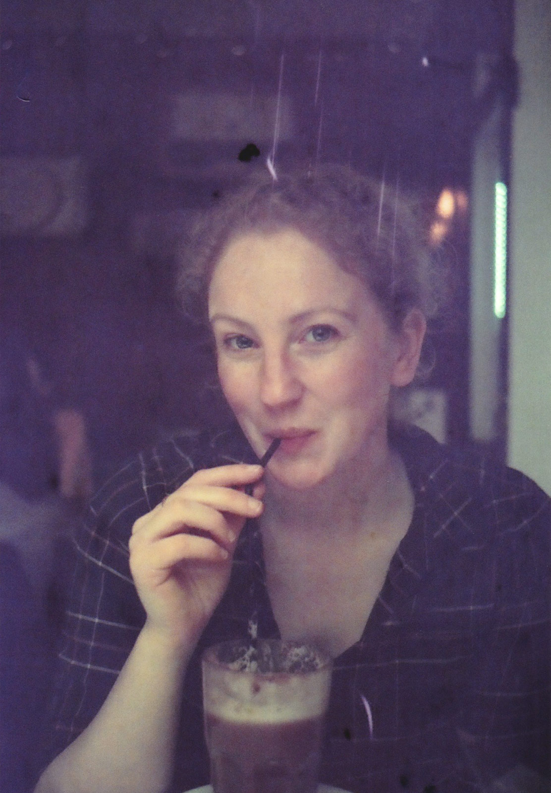 Woman drinking through straw