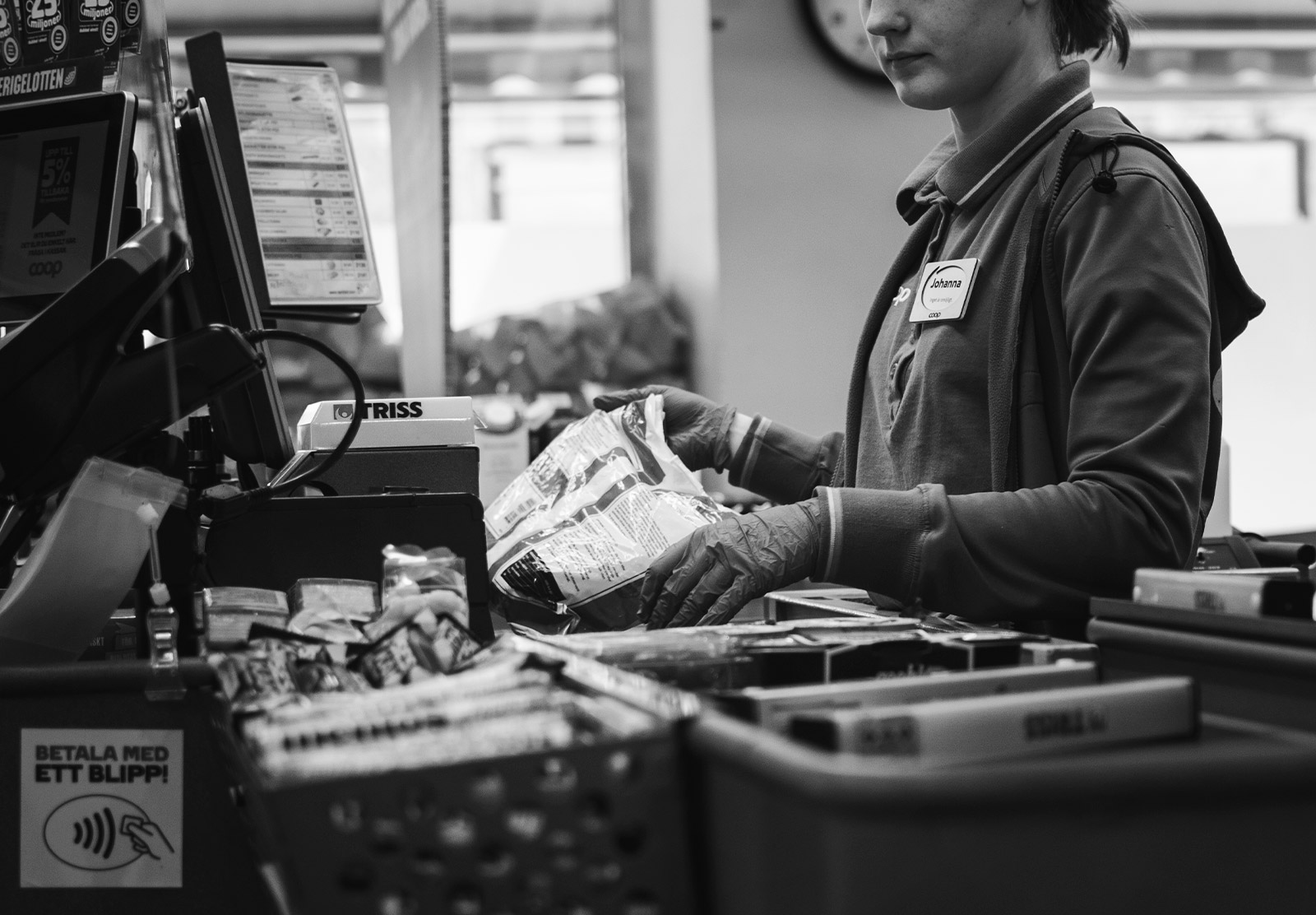 Cashier wearing gloves