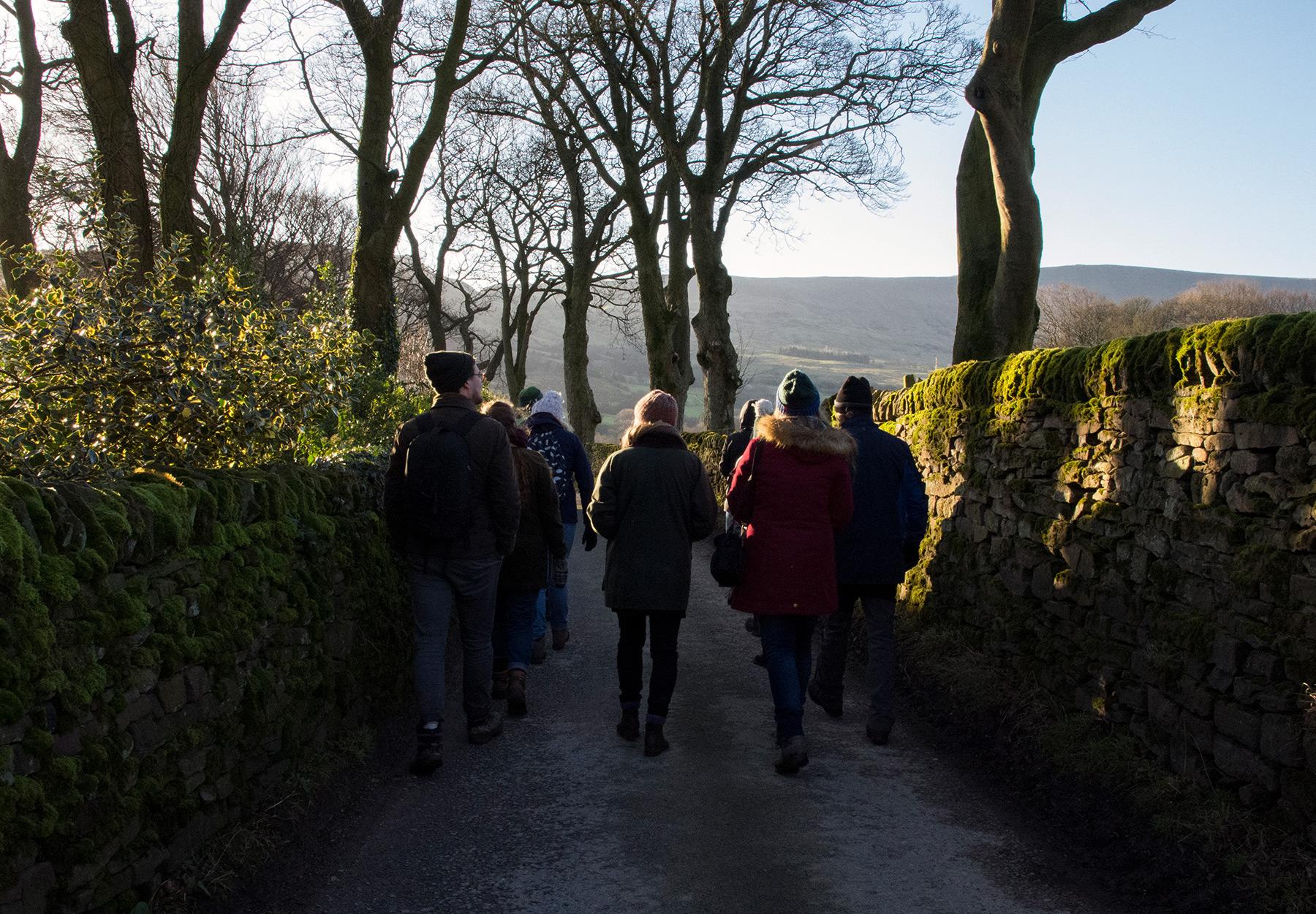 People walking along lane