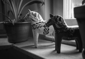 Wooden horse on windowsill