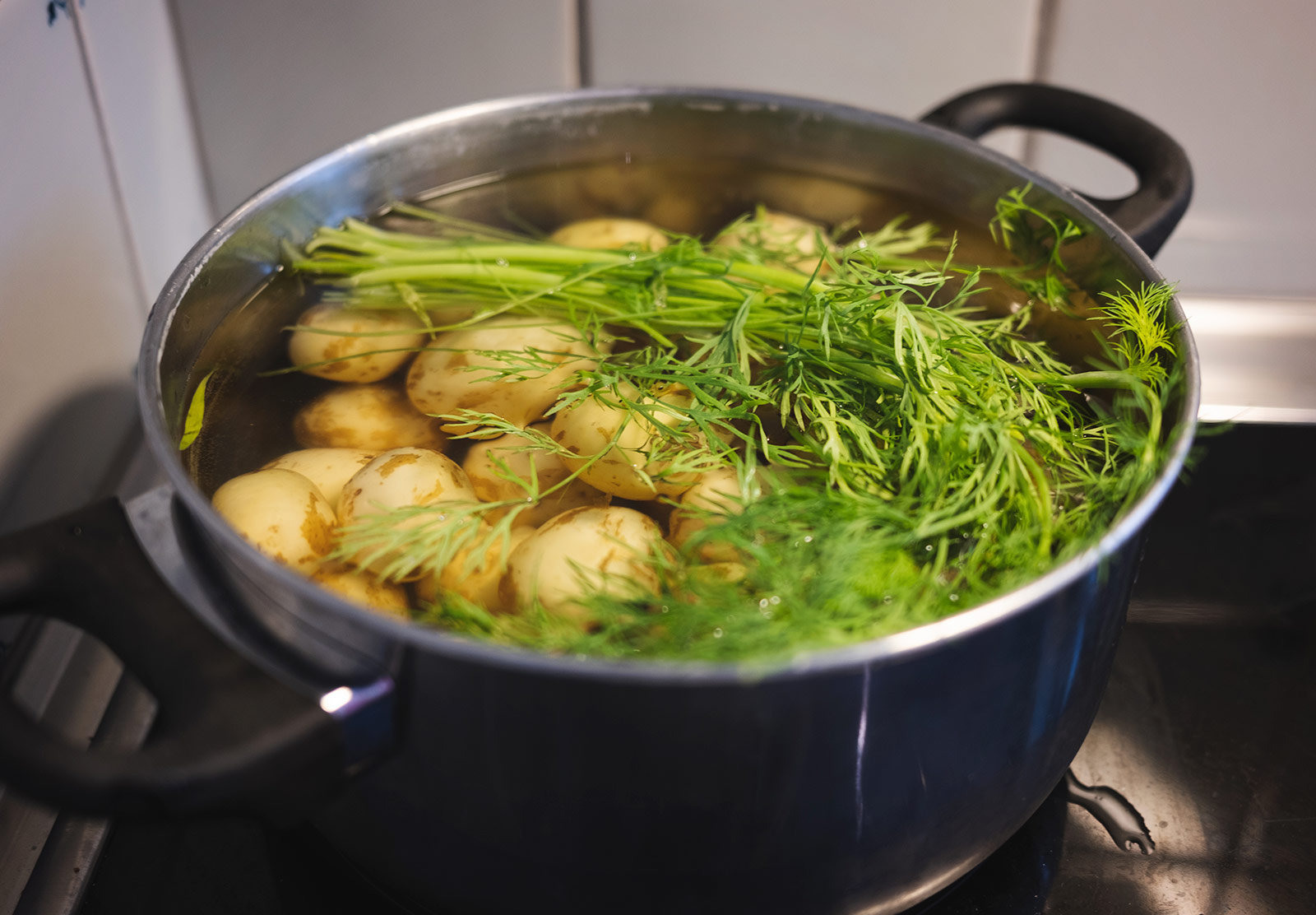 Potatoes and dill in a pan
