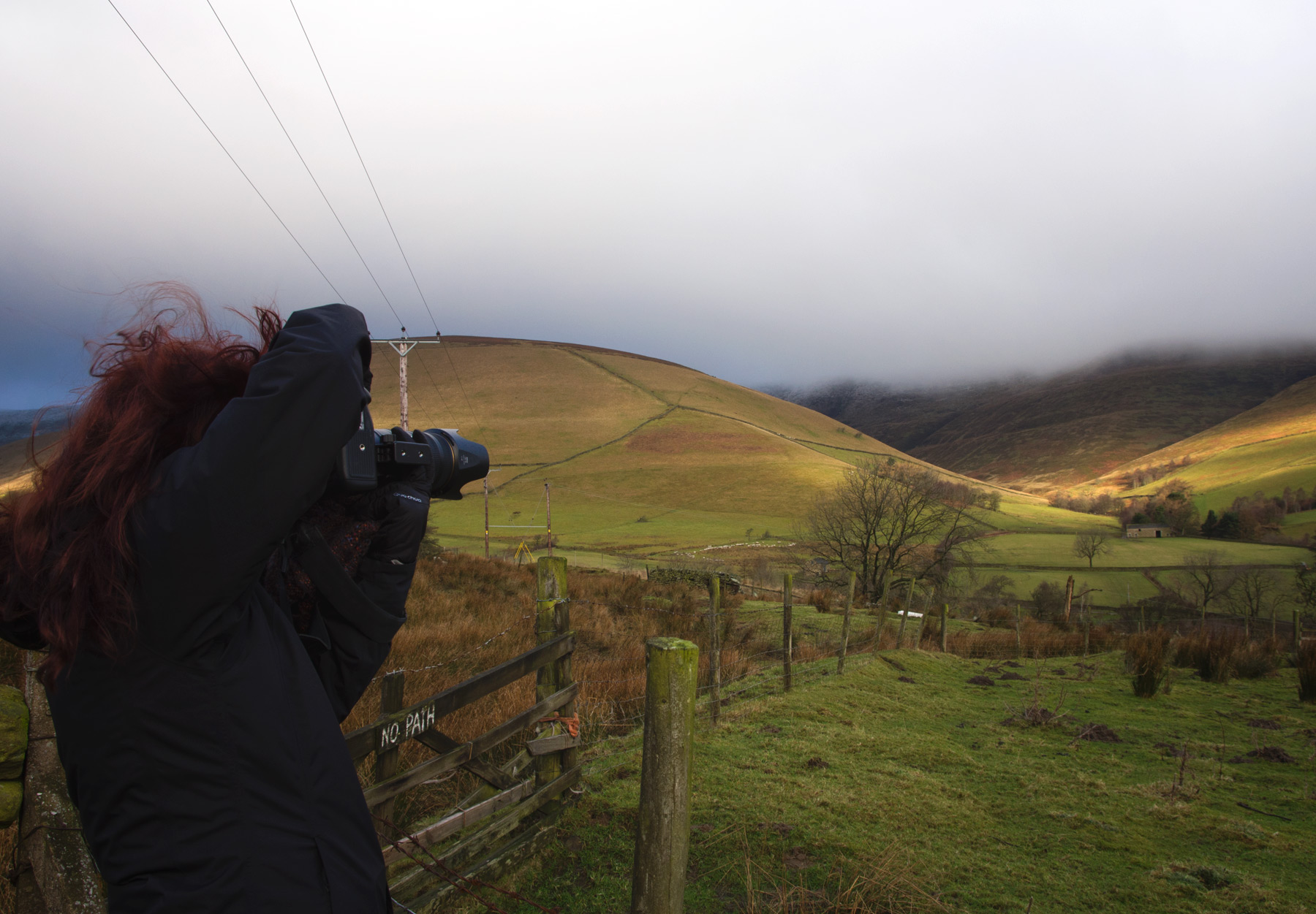 Woman photographing hills