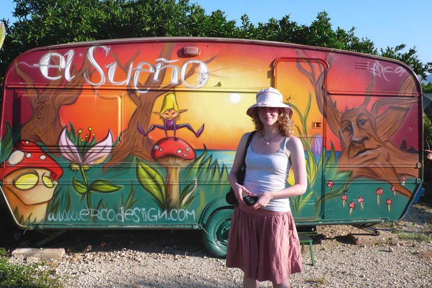 Me stood by a painted caravan
