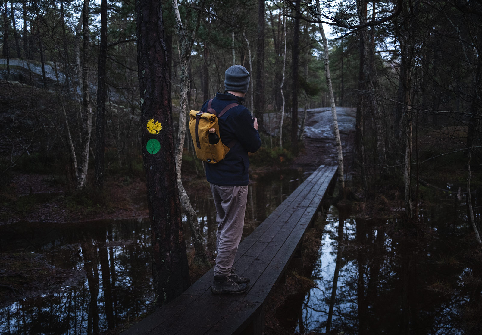 Man walking on wooden boards