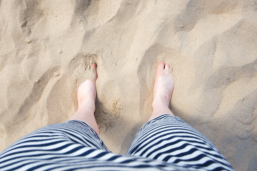 Feet covered in sand