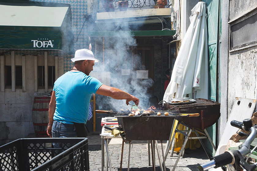 Man grilling fish outdoors