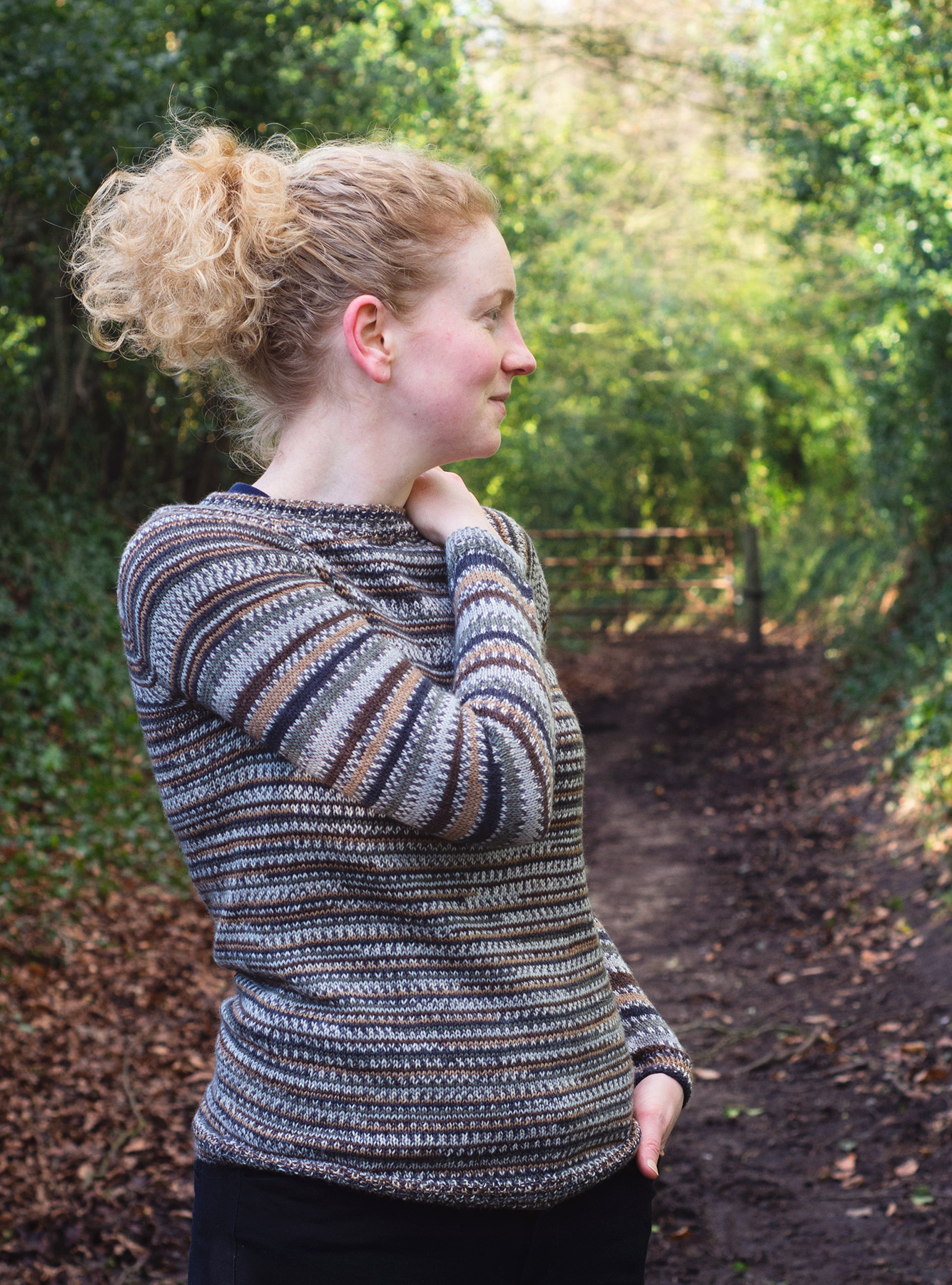 Woman in knitted jumper looking sideways