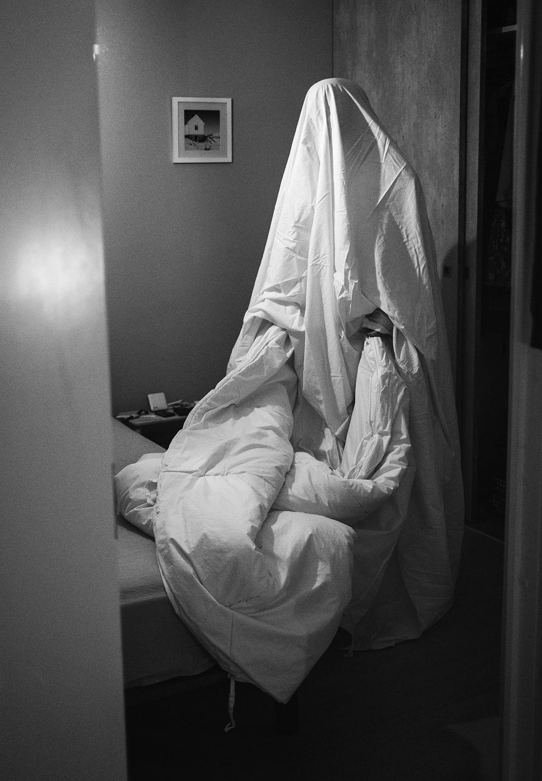 Man under sheet